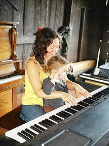 Julie at piano with Aine
